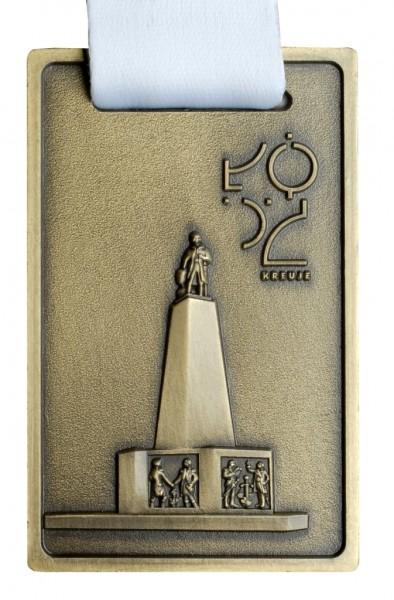 Medal zwygrawerowanym posągiem